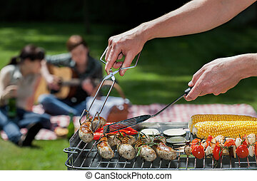 Musical bbq - A summer barbeque with guitar music and...