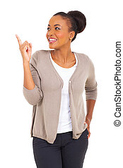 african woman pointing up