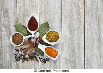Colorful spices assortment on a wooden talbe in the kitchen