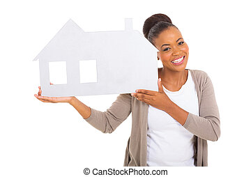 real estate agent holding paper house isolated on white...
