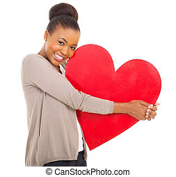 cute african woman holding heart - cute african woman...