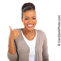 african businesswoman with thumb up gesture - cheerful...