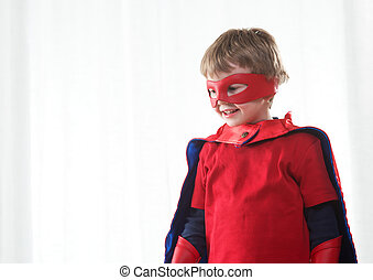 Superhero kid - Smiling super hero kid with red mask and...