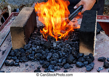blacksmith furnace with burning coals - outdoor Old...