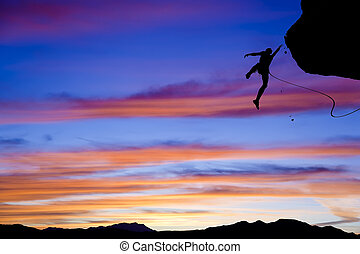 Rock climber falling. - Climber in trouble clinging to a...