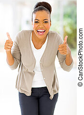 african woman giving two thumbs up - cheerful african woman...