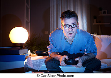 Playing videogames late at night - Man playing videogames...