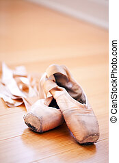 ballet slippers in a well-worn condition