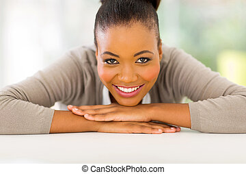 young african woman relaxing at home - attractive young...