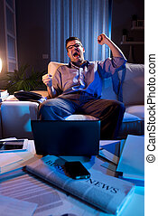 Good news for stock investor - Businessman sitting on sofa...
