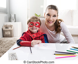 Drawing together - Mother and superhero child playing and...