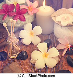 Spa treatment setting with frangipani