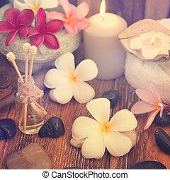 Spa treatment setting with frangipani