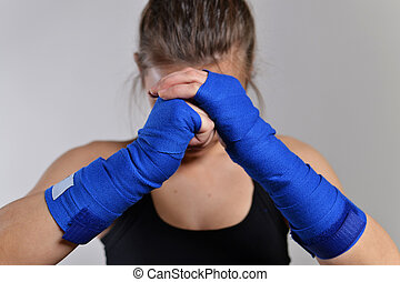 Ready to fight - fitness woman boxing, studio shot