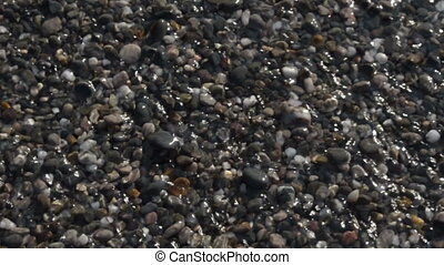 Pebble beach sea shore, transparent crystal shallow water...