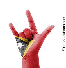 Hand making I love you sign, East Timor (Timor-Leste) flag...