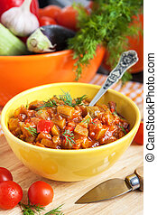 Vegetable stew (Ratatouille) in yellow bowl on the table
