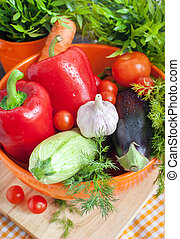 Fresh vegetables (ratatouille ingredients) in  bowl on table