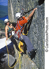 Team of rock climbers. - Team of climbers battle their way...