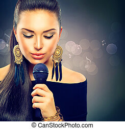 Beautiful Singing Girl. Beauty Woman with Microphone