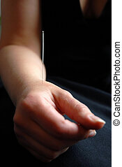 Acupunture needle - The doctor uses needles in the hand for...