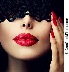 Beautiful Woman with Black Lace Mask over her Eyes