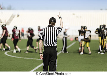 American football referee with hand up - football referee...