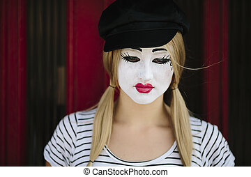 Female Mime -  sad mime with black hat on the red background