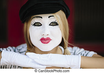 Female Mime -  mime with black hat on the red background