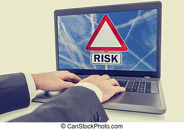 Laptop screen with a sign with the word - Risk