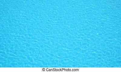 Pattern of small ripples in the blue water pool