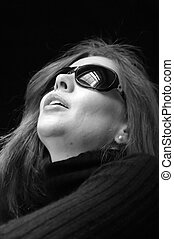 portrait of beautiful woman wearing sunglasses in black and...