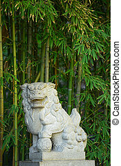 chinese stone lion - chinese garden with stone lion