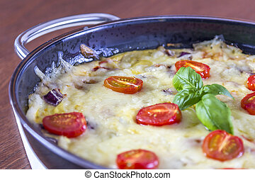 Omelette in pan - Omelette with tomatoes cheese and fresh...