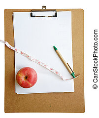 Red apple and tape measure isolated on white