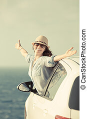 Vacations - Happy woman at the beach Summer vacations and...