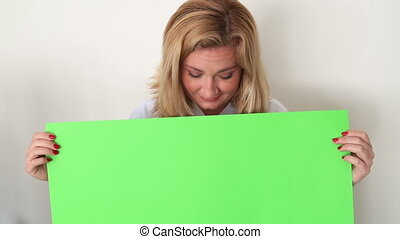 Female doctor Holding Onto A Green Screen