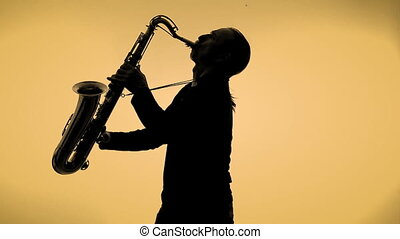 Saxophone player in a color background - Saxophone player in...