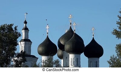 black birds over golden crosses - view of the Russian...