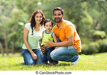 happy indian family outdoors - portrait of happy indian...