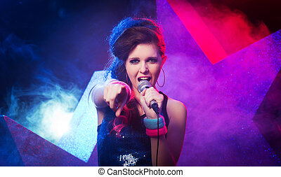 Young rock star performing - Young beautiful girl singing on...