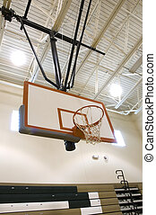 Baskeball Hoop in High School Gymnasium.