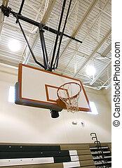 Baskeball Hoop in High School Gymnasium.