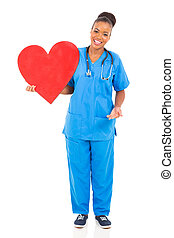 young african american doctor holding heart - beautiful...