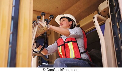 Industrial Female Grader Thumbs Up - Female in white hard...