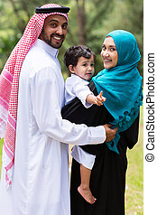 happy islam family looking back