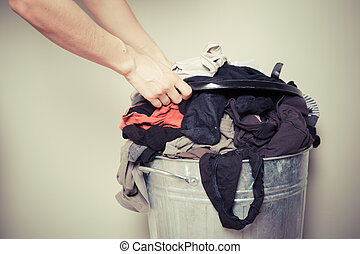 Woman sorting out her laundry - Young woman is sorting out...