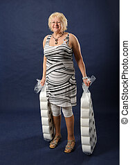 Woman with big packs of toilet paper.