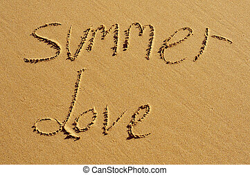 summer love - the text summer love written in the sand of a...