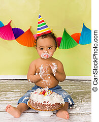 Cake smash baby boy - Adorable african baby during a cake...